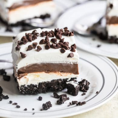Chocolate lasagna slice on a white plate.