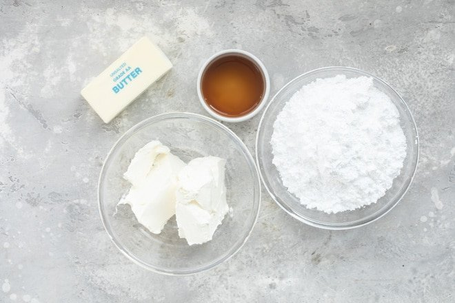 Cream cheese frosting ingredients in various bowls.
