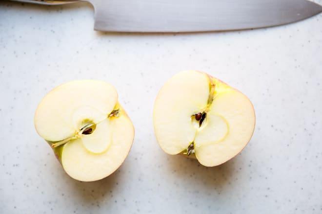 An apple cut in half.
