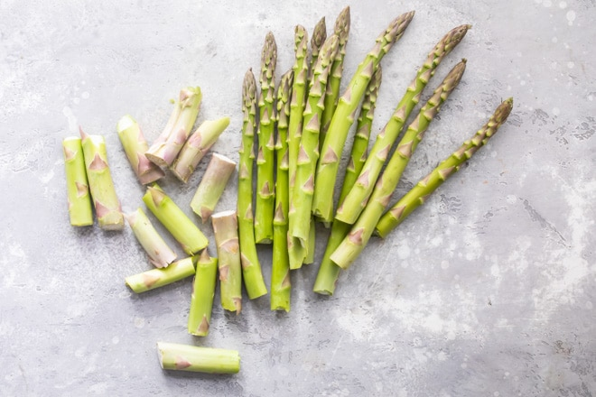 Snapped raw asparagus.