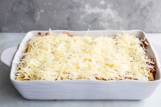 Pre-baked best make ahead lasagna in a white baking dish.