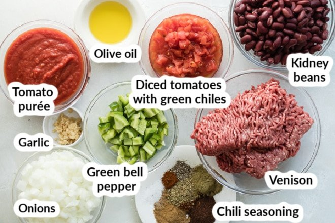 Labeled venison chili ingredients in bowls.
