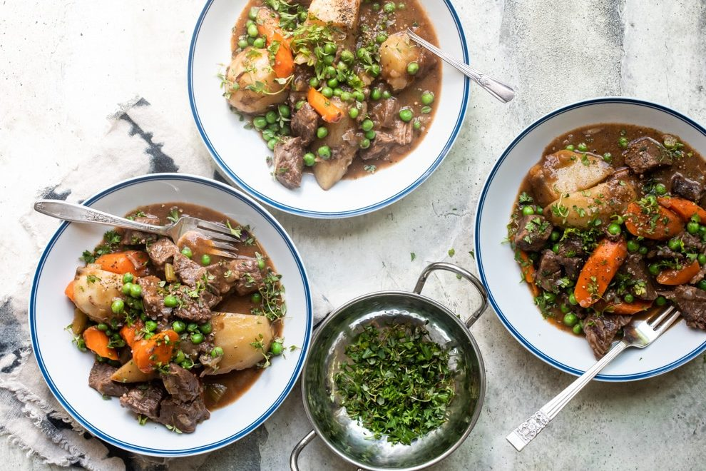 Beef stew in white bowls.