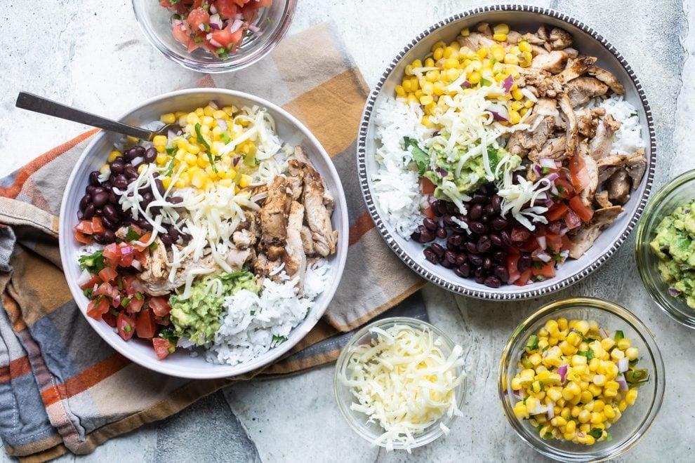 Chipotle burrito bowls in white bowls.