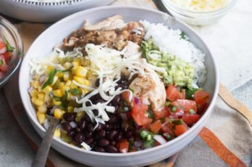 A chipotle burrito bowl in a white bowl.
