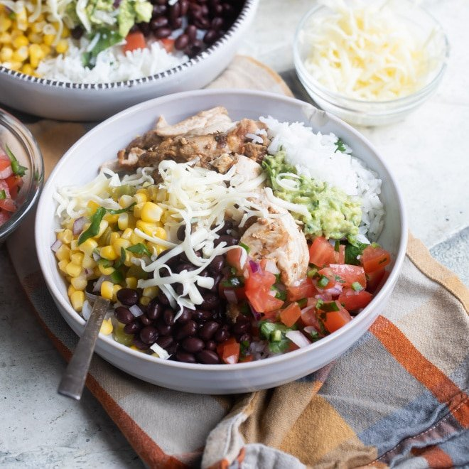 Chipotle burrito bowl in a white bowl.