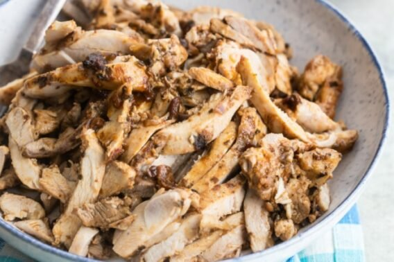 Chipotle chicken in a white serving bowl.