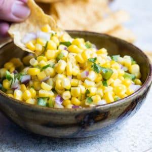 Chipotle corn salsa in a black bowl.