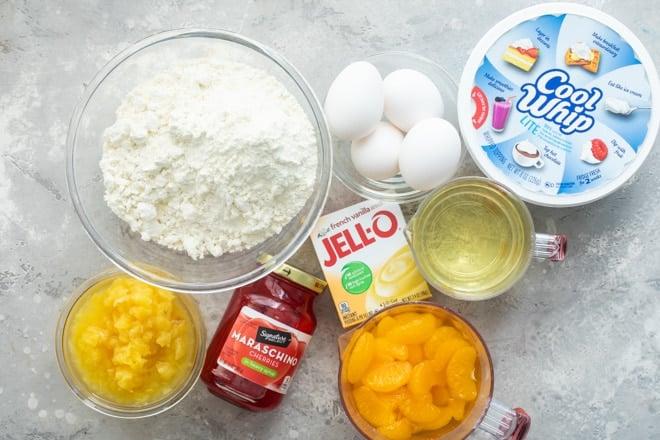 Hawaiian wedding cake ingredients in various bowls.