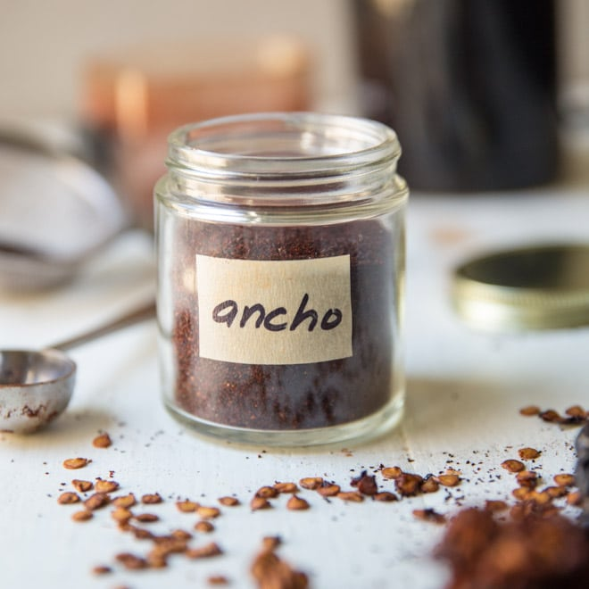 Homemade ancho chile powder in a glass jar.