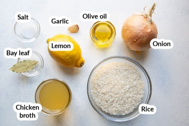 Labeled lemon rice pilaf ingredients in bowls.