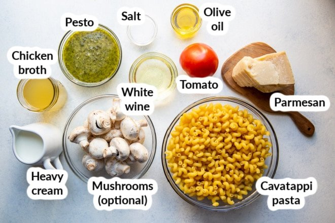 Labeled pesto cavatappi ingredients in bowls.