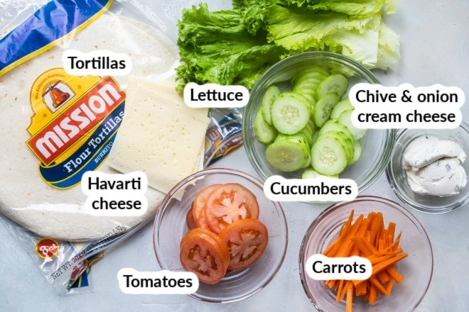 Labeled veggie wrap ingredients in bowls.