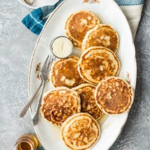 Vegan pancakes on a white platter.