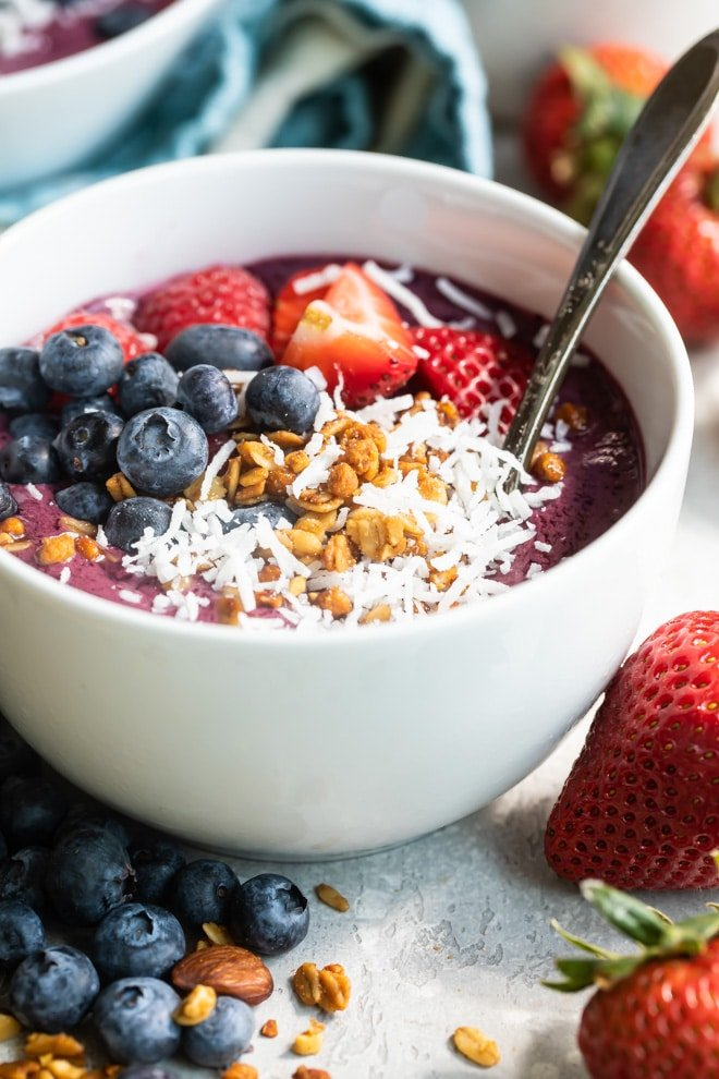 Easy acai bowl in a white dish with a spoon.