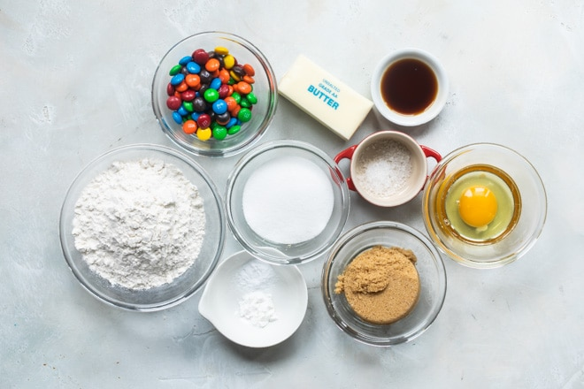 The ingredients portioned out for making M&M cookies.