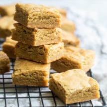 Blondies on a stack on a cooling rack.