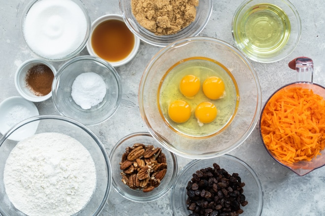 Carrot cake ingredients in various bowls.