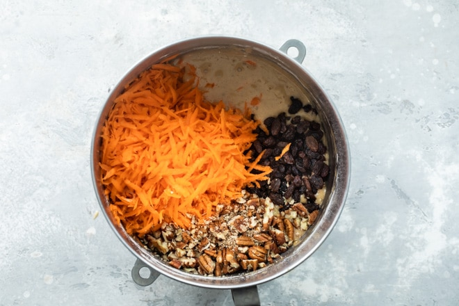 Carrot cake ingredients in a sliver pot.