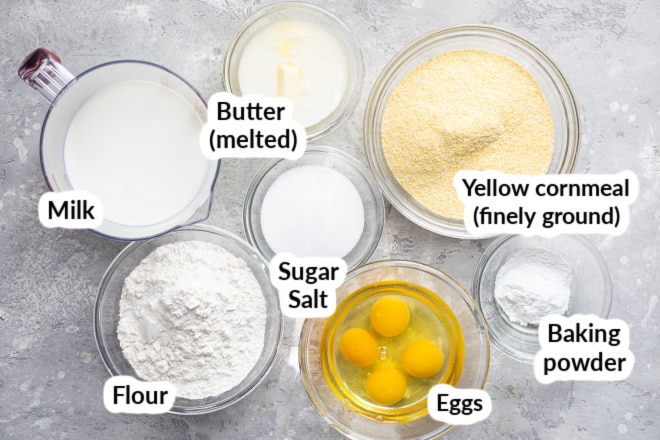 The ingredients for cornbread in bowls and labeled.
