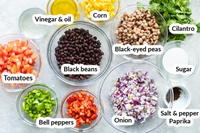 Cowboy caviar ingredients in various bowls.