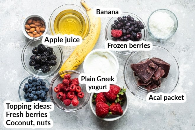Labeled Ingredients for an easy acai bowl in various clear dishes.