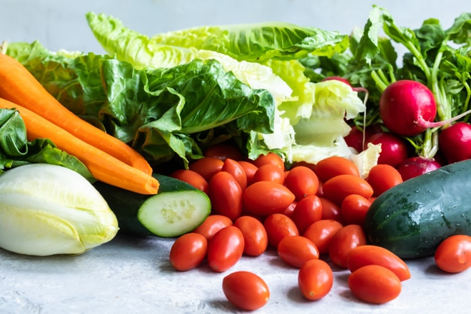 Lettuce, carrots, celery, cherry tomatoes, and beats all in a pile.