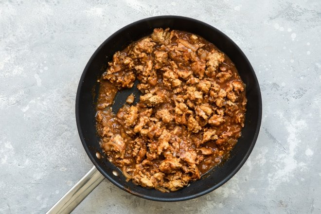 Ground chicken taco meat in a black skillet.