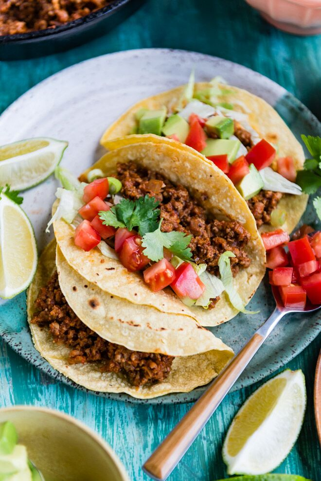 Ground chicken tacos on a blue plate.