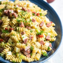 Italian pasta salad on a blue platter.