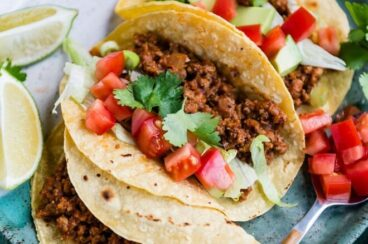 Three Ground Chicken Tacos on a blue plate
