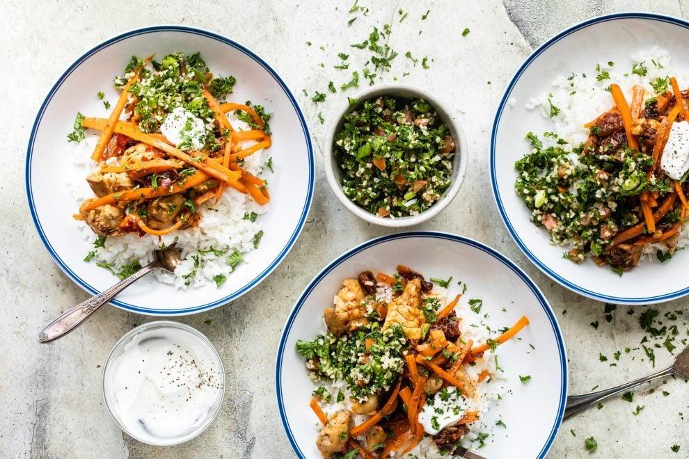 Three bowls of Harissa Chicken over rice.