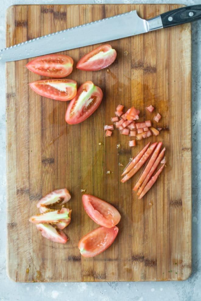 Seeded tomatoes on a cutting board.