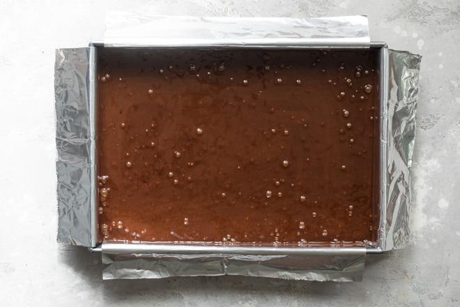 Brownie batter in a pan.