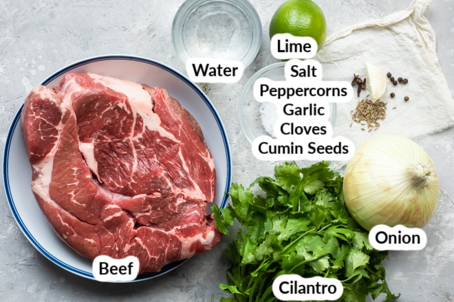 Birria ingredients in various bowls.