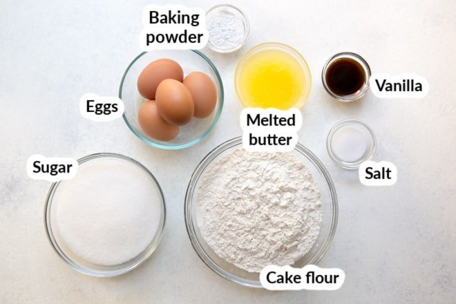 Labeled easy pound cake ingredients in various bowls.