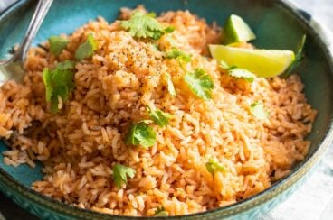 Mexican rice in a teal bowl.