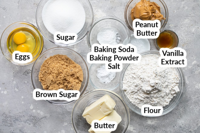 Peanut Butter Cookie Ingredients in various bowls.