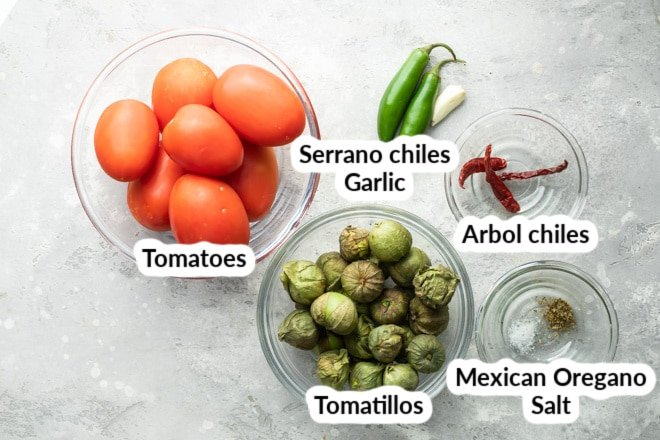 Salsa de Birrio ingredients in clear bowls.