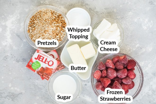 Labeled strawberry pretzel jello salad ingredients in various bowls.