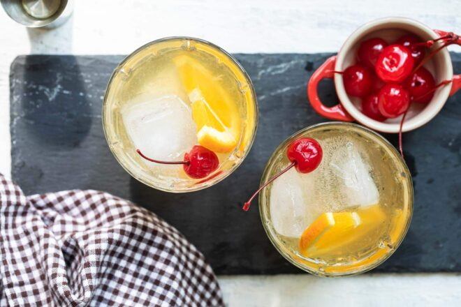 An amaretto sour cocktail in a clear glass.