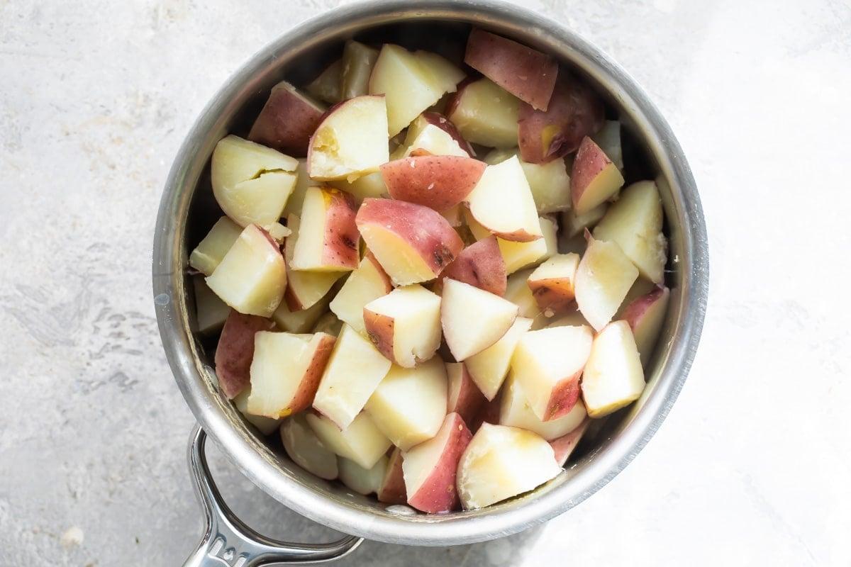 Boiled/cut potatoes in a pot.