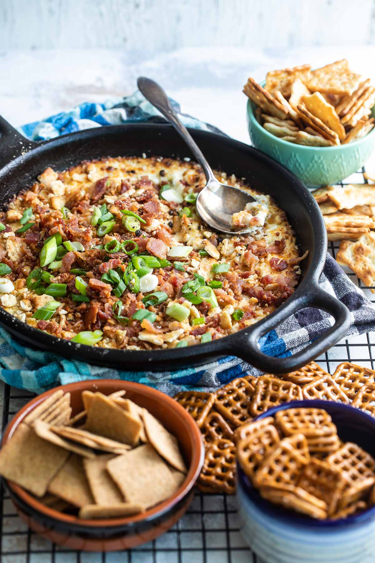Cheesy bacon dip in a cast iron skillet.