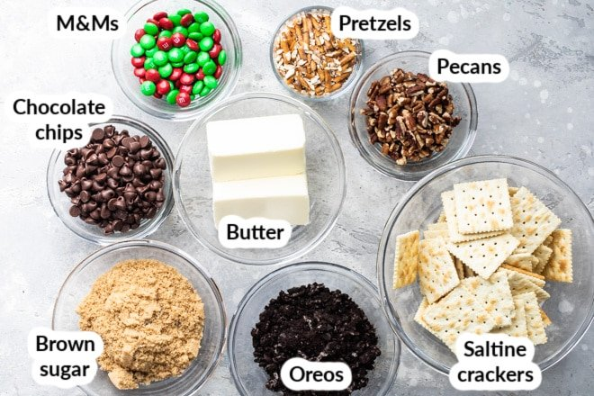 Labeled ingredients for Christmas crack in various bowls.