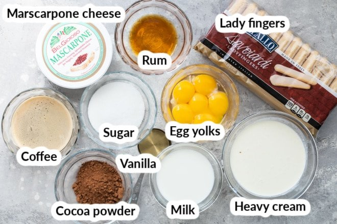 Labeled tiramisu ingredients in various bowls.