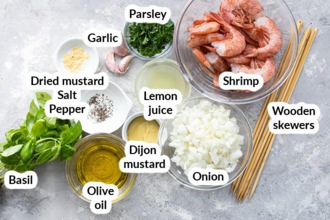Labeled grilled shrimp skewer ingredients in various bowls.