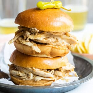 2 hot turkey sandwiches piled on a plate.