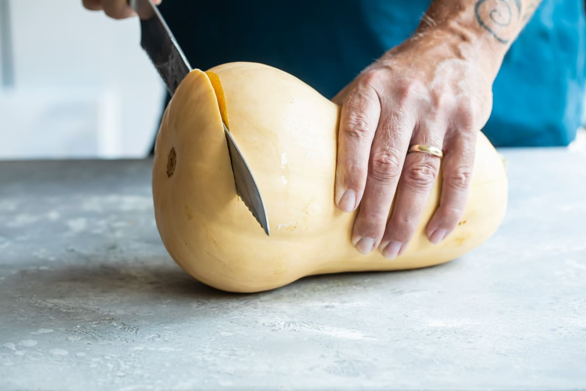 The end being trimmed off a butternut squash.