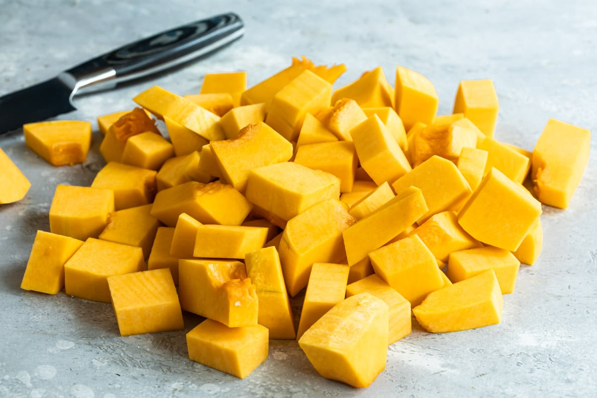 Peeled butternut squash diced into cubes.