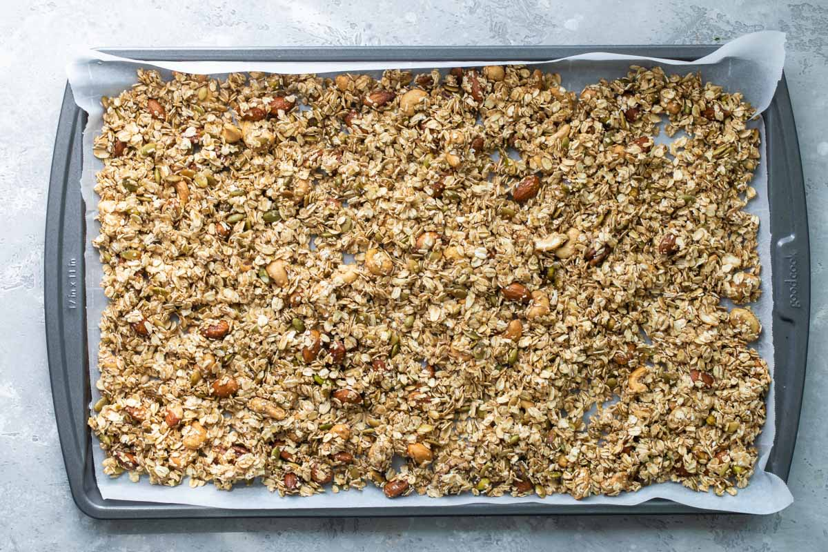 Granola on a baking sheet before being baked.